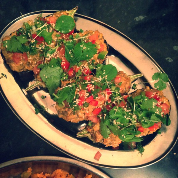 Aubergines stuffed with aubergine puree, moroccan spices, dressed with sesame seeds, herbs and diced vegetables