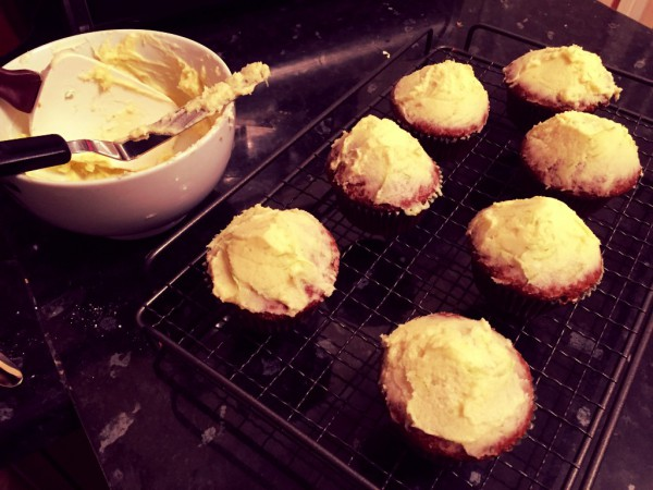 Carrot cake muffins, spiced with cinnamon and coriander; lime buttercream