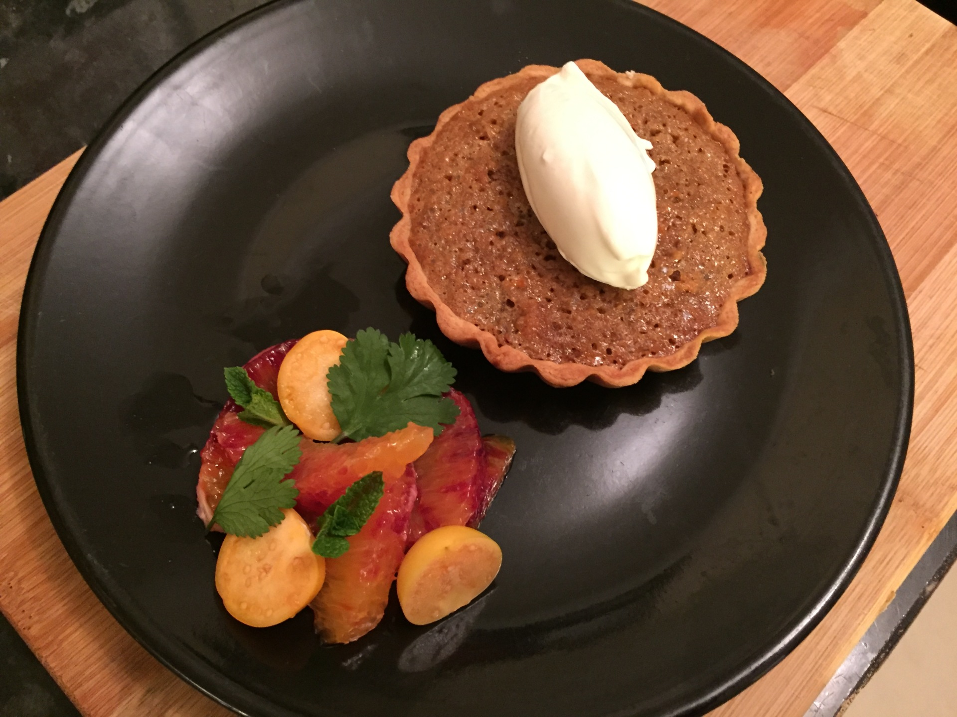 Blood orange treacle tart, orange blossom cream, physalis and blood orange segments
