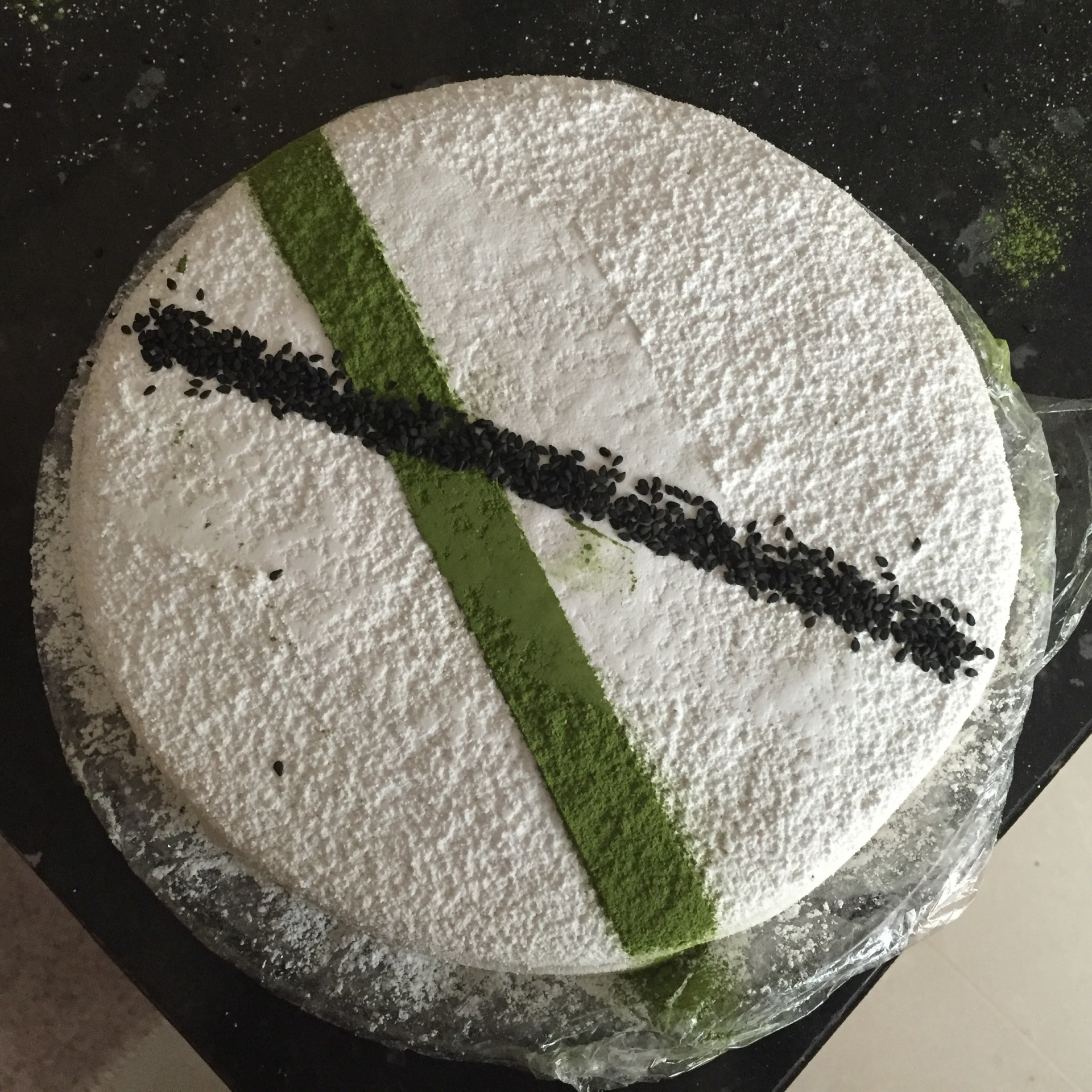 Matcha green tea mousse, black sesame cake, marshmallow topping