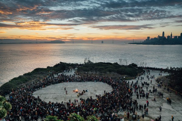 Thousands of people gather for the Indigenous People's Thanksgiving Sunrise Gathering at Alcatraz Island in San Francisco on Thursday, Nov. 23, 2017. ©Sarahbeth Maney/Xpress News