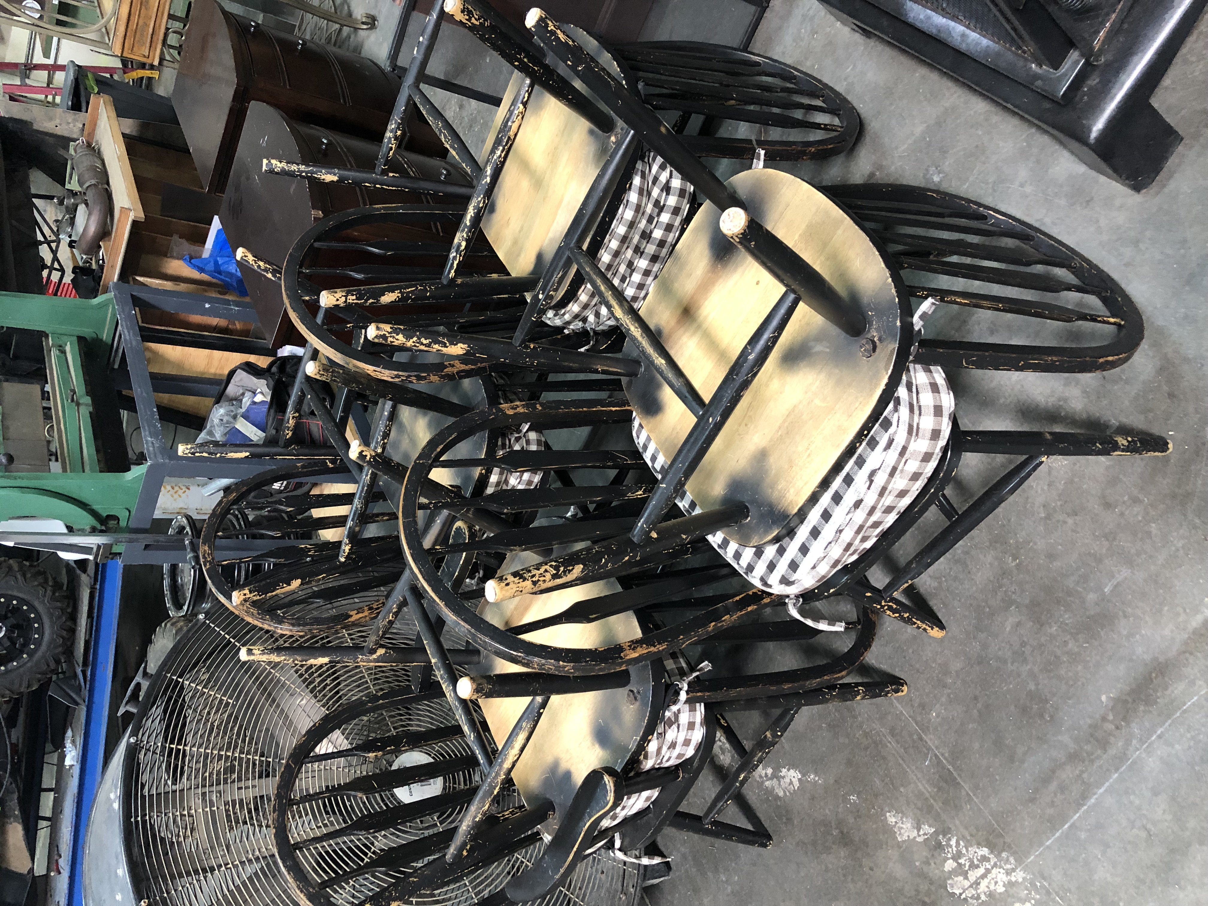 Eight black dinner chairs