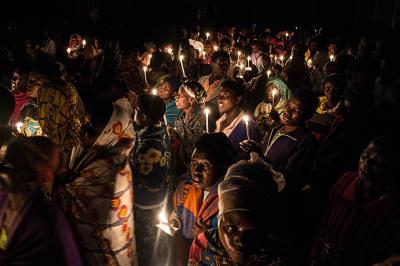 Rwanda, Kibheo. Crowd at night procession.