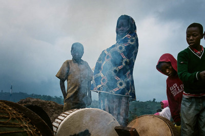 Rwanda, Kibeho. In a mix of Christian and local tradition, children playing drums during Mass