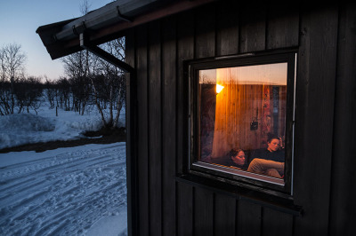 Norway, near Karasjok. Anne and Kristine take some rest in one of the shelter of the Reindeer Police