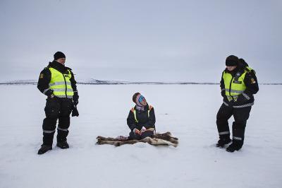 Norway, Finnmark. Hanna Bremseth and Kristine Veriaervi talking with a Sami woman