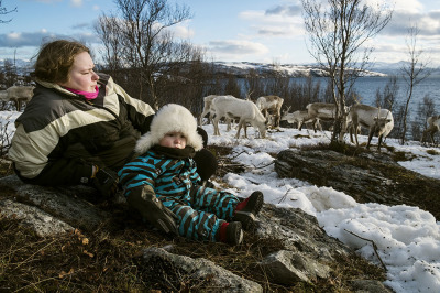 Norway, Alta, Skillefjorden. A Sami girl and her little sister waiting for the boat to move their flock  on the islands.