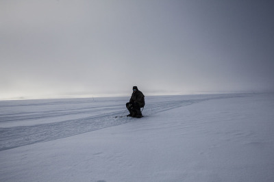 Norway, Finnmark. Fishing on the frozen lake. Tourists and Norwegian people need a special license to fish.