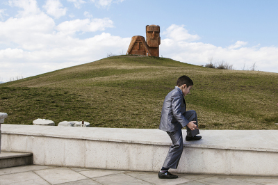 """Stepanakert, NKR. Children from a local private school visiting Tatik & Papik monoument, known also as """"we Are Our Mountains"""", that represent the Armenian heritage of Nagorno-Karabakh."""