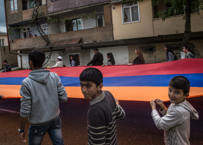 Stepanakert, NKR. Children and teen agers carry a flag 300 meters long in occasion of the demonstration of every 9th of may that celebrate a triple anniversary for Karabakhian people:  the liberation of the city of Shushi that ends the first war against Azerbaijan, the celebration of the creation of the Karabakhian army and the victory of the second world war