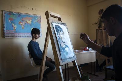 Shushi, NKR. Shushi Liberal Arts College Arsen Khachatryan. Tigran Khachatryan 17 yrs, posing as a model for the portrait lesson.