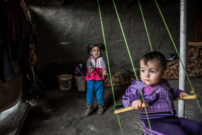 "Madagis village, Martakert region,NKR. Suren Grigoryan's nephews are playing on a swing in the backyard of their granfather's house. ""The population is growing and we don't have enough space for children like kindergardens or schools""."