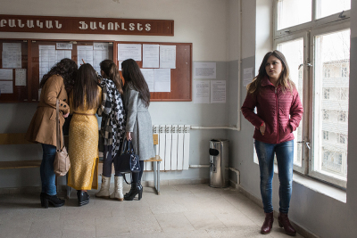 Stepanakert, NKR. Artsakh state university. A group of female students are checking the lessons timetable during a break. Being an unrecognized country, graduation has value only in NKR and Armenia.