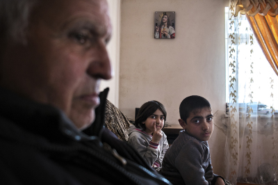 """Madagis Village, Martakert region. NKR. In the house of Avanesyan family, 6 kids. They fled Azerbaijan in 1988 at the beginnig of the rising tensions. """"each armenian must live in his father Land/Ethnical area"""""""