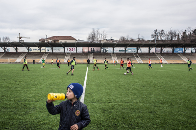 Stepanakert, NKR. City stadium. During a friendly match between the Lernayin Artsakh Football club and its youth team. In the NKR League there are 10 teams and the national footbal team plays in the international championship of unrecognized countries.