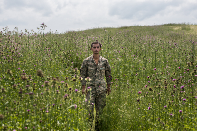 NKR Frontline with Azerbaijan, Hadrut region. Erik Tovmasyants, 19 portraited in a thistle field along the frontline. Along the contact line, the closest point between the two armies is just 200 meters. During the 4 days war 85 Armenian-Karabakhian soldiers were killed and more than 300 were wounded.