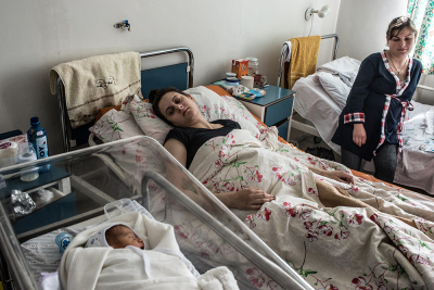 Stepanakert, NKR. Two young mums and a new born in the maternity hospital