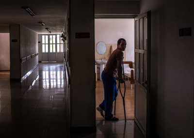 Stepanakert, NKR. A young wounded soldier recovered in the military hospital of Stepanakert stands on the door of his room.  He  was shooted to his left leg by the Azeri army during the 4days war in which 85 Armenian-Karabakhian soldiers were killed and more than 300 were wounded.  In the hospital daily arrive injured from the frontline. Most of all are very young.