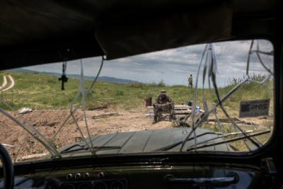NKR Frontline with Azerbaijan, Hadrut region. Young soldiers daily life's inside the trenches. View from inside a military vehicle of a soldier who is resting after an hard turn of guard in the trenches.