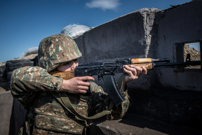 NKR Frontline with Azerbaijan, Agdam area. A sniper looking for a target on the enemy lines. Along the contact line, the closest point between the two armies is just 25 meters and the skirmishes are increasing.