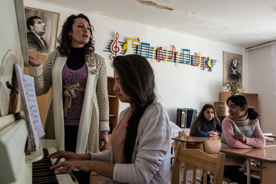 Shushi, NKR. Liberal Arts College Arsen Khachatryan. Larisa Davtyan and some students during their daily painting lesson. Marina Vardanyan, 30 years old, teacher of traditional music during her lesson with Erica Sargsyan (16), Larisa Zakaryan (14) and Knar Avanesyan (15).
