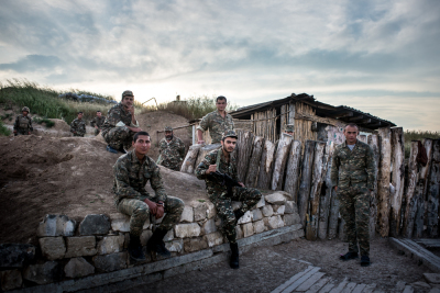 NKR Frontline with Azerbaijan, Hadrut region. Young soldiers daily life's inside the trenches. A group of soldiers portraited in a moment of rest in the base camp inside the trenches.