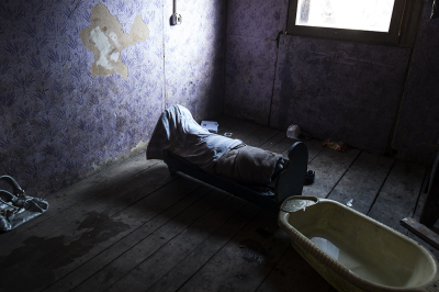 Camp Konic, Podgorica, Montenegro. A little sick child is sleeping in a shack with no water, covered with a veil.