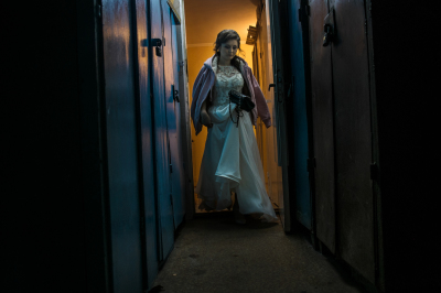 Tiraspol, Pridnestrovie. A bride on her wedding day is coming out of her apartment in a popular district of the city