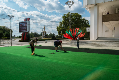 Tiraspol, Pridnestrovie. A group of workers are cleaning and preparing the area in front of House of Culture in the city center for an upcoming event organized to celebrate the 10th anniversary from the referendum that, on september,17,2006  acknowledged the friendship between Russia and Pridnestrovie. The annexation of the Crimea to Russia has led the government of Pridnestrovie to hope to be able to quickly achieve the same result. Actually the position of Russia is different because the relations between Russia and Moldova are better than those with Ukraine.
