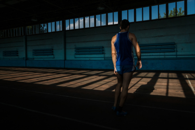 Tiraspol, Pridnestrovie. Athletic stadium,  Daily trainings of a runner. All the Pridnestrovian athlets are forced to compete under the flag of an other nation because Pridnestrovie being unrecognized, cannot partecipate in any international sport event.