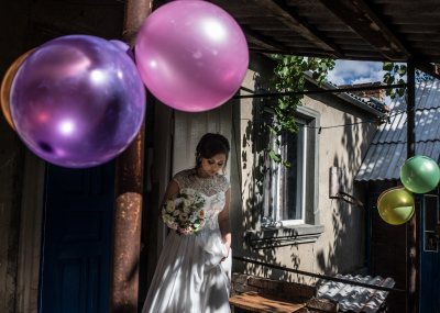 Tiraspol, Pridnestrovie. Alla on her wedding day in front of her parents apartment in a popular district of the city on her way to the ortodox church