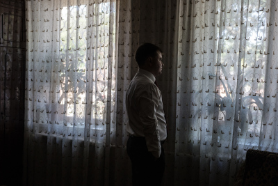 Tiraspol, Pridnestrovie. Sergej on his wedding day in his parents apartment, located in a popular district of the city, before going to visit and take his future bride from her family's house to the ortodox church they have chosen for the rite.