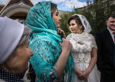 Tiraspol, Pridnestrovie. Alla on her wedding day is waiting with her future husband Sergej, her mother and her grandmother to start the ceremony of their wedding outside the ortodox church they have chosen for the rite in a popular district of the city