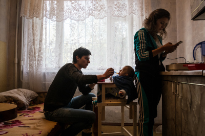Tiraspol, Pridnestrovie. Arseniy Stelya, 26 years old with Elisabeth Nalivaico, 20 years old and their kid Kirill, 7 months in their house. She left her work to be a mum, He wants to become a journalist. His life is completely changed after the born of Kirill because he found the strengh to quit using drugs. They earn 300$ per month and receive 100$ extra from the government  as a social aid to young couples.