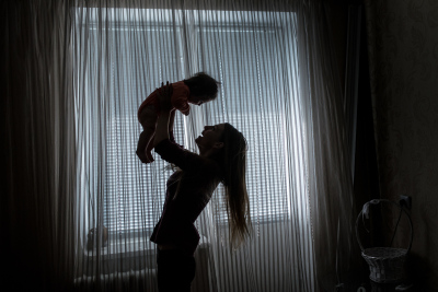 Slabadzia, Pridnestrovie. Anna Getman, 23 plays with her daughter Alissa, 4 months years old in her apartment. Anna is a wedding photographer. She is part of the middle class and she is not among those who want to leave the country but she preferes to stay and build her own future in Pridnestrovie. She hopes that the international community will recognize the country because she cannot travel as much as she would because the passport is unrecognized as well as the currency. She thinks that at the moment there isn't a real Pridnestrovian culture but she hopes to grow up her kid as a real Russian.