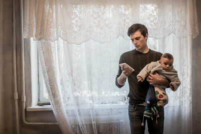 Tiraspol, Pridnestrovie. Arseniy Stelya, 26 years old with his kid Kirill, 7 months in their house. He wants to become a journalist. His life is completely changed after the born of Kirill because he found the strengh to quit using drugs. The family earns 300$ per month and receives 100$ extra from the government  as a social aid to young couples.