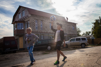 Tiraspol, Pridnestrovie. Kids playing in the streets of Kirovski district, one of the poorest area of the city. Most of the inhabitants of this discrict lost their jobs due to the economical crisis. The international embargo caused the failure of the 80% of the industries