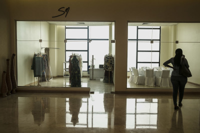 Sonia Mugabo in her shop inside the luxury hotel Marriot in Kigalo. Sonia Mugabo (SM) is a Rwandan fashion brand, established under the owner's name in 2013
