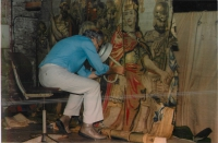 Our founder, Mr Samuel Behar, examining and repairing an antique Tapestry