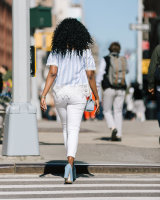 Black girl walking back