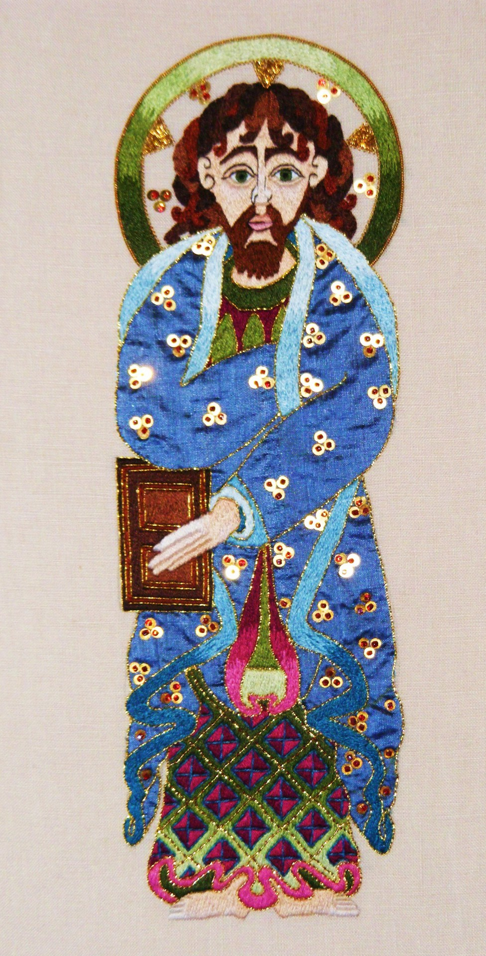Saint Matthew from the Book of Kells in appliqué and surface stitching with gold &bead detailing