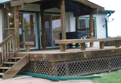 Deck in back has benches & BBQ grill, leads to patio