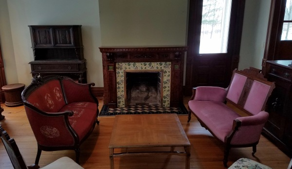 Second Parlor with tiled fireplace