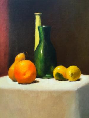 Lemons and green bottles