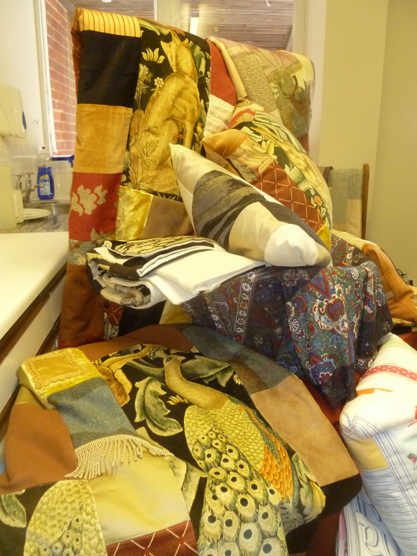 Cornucopia of luxurious blanket & cushions