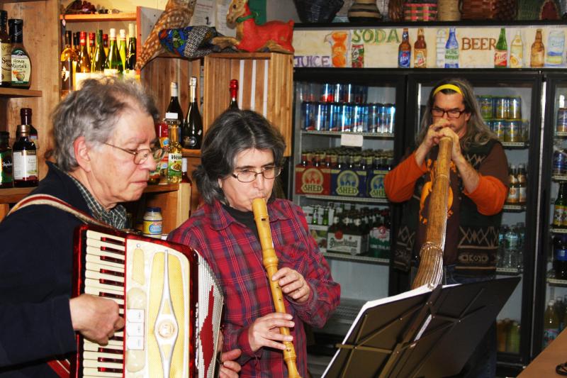 Photo caption: Local musicians Rick Winston (accordion), Sara Coperansky (recorder), and Pitz Quatt