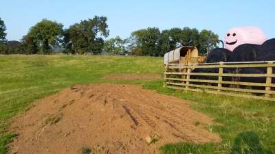 Using the soil to level a banking to allow tractor access.
