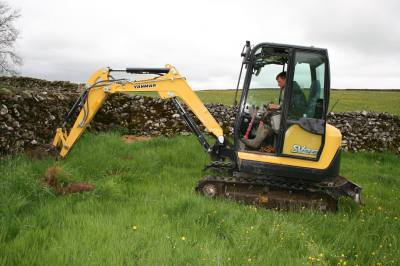 Digger making a trench
