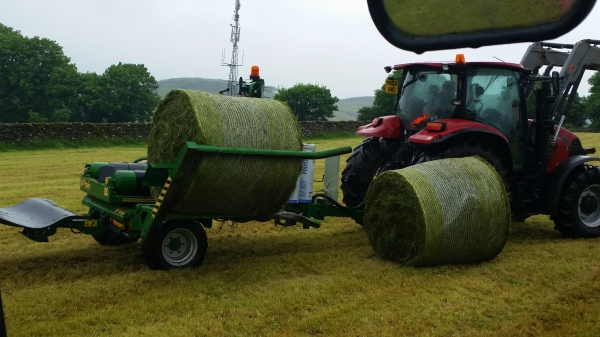 The wrapper picks up the bale