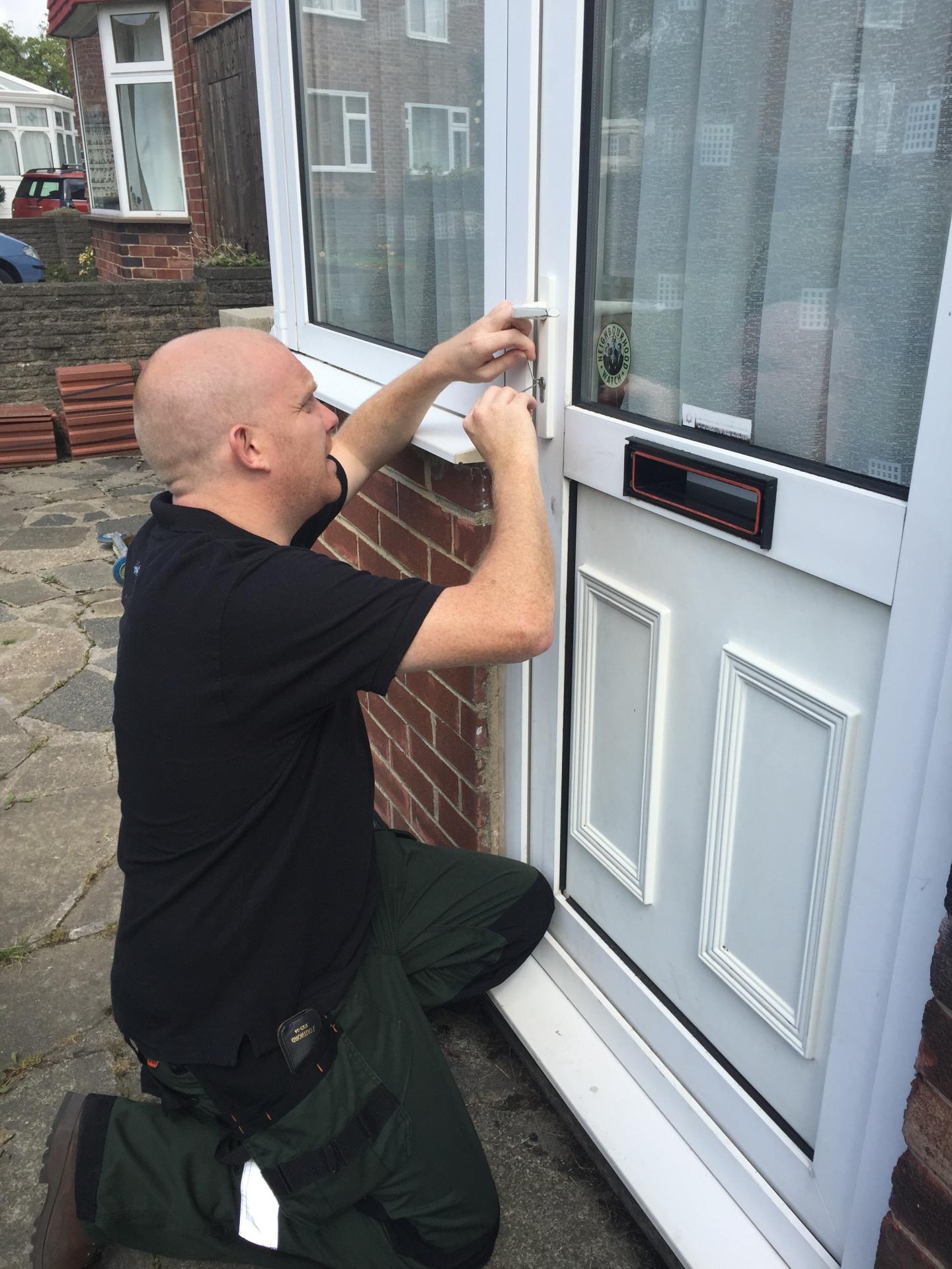 Locksmith Picking Door Open